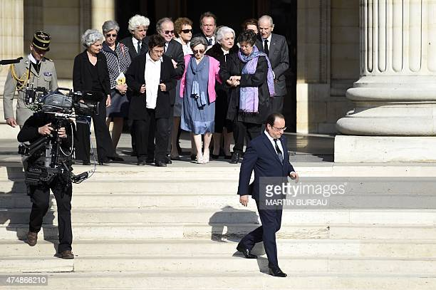 French President Francois Hollande walks out of the Pantheon in front of people during a ceremony honouring the four World War II resistance fighters...