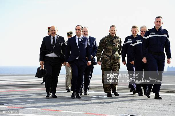 French President Francois Hollande walks with French Defence minister JeanYves Le Drian French Army Chief of Staff General Pierre de Villiers...