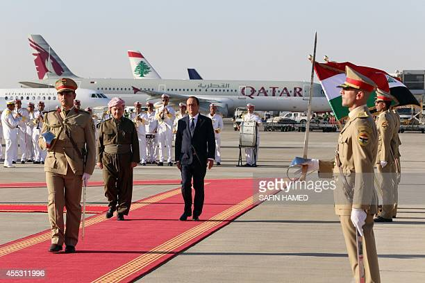 French president Francois Hollande walks with Iraqi Kurdish leader Massud Barzani upon the former's arrival in Arbil the capital of the Kurdish...