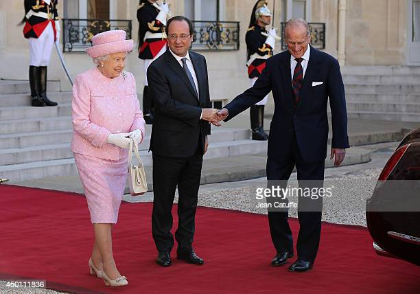 French President Francois Hollande walks with Queen Elizabeth II and Prince Philip Duke of Edinburgh as they depart the Elysee Presidential Palace...