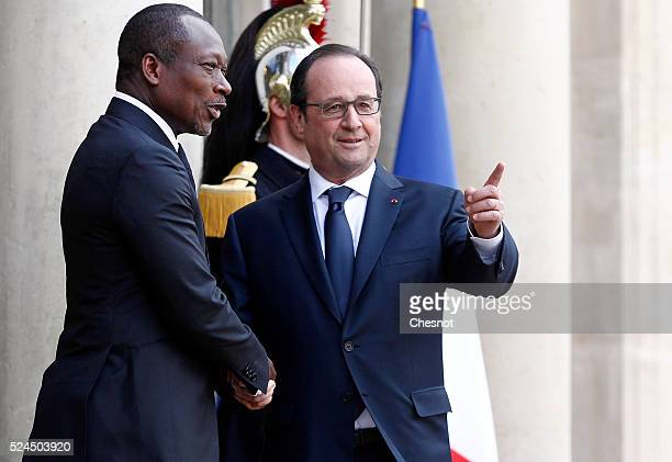 French President Francois Hollande welcomes Benin's newly elected President Patrice Talon prior to attend a meeting at the Elysee Presidential Palace...