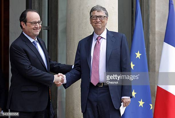French President Francois Hollande welcomes Bill Gates the coFounder of the Microsoft company and coFounder of the Bill and Melinda Gates Foundation...
