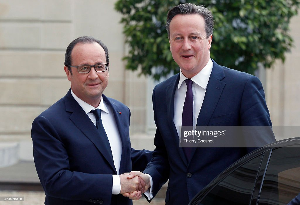 French President Francois Hollande welcomes British Prime Minister David Cameron prior a meeting at the Elysee Palace on May 28, 2015 in Paris, France. David Cameron meets Francois Hollande to discuss the situation concerning the United Kingdom in the European Union.