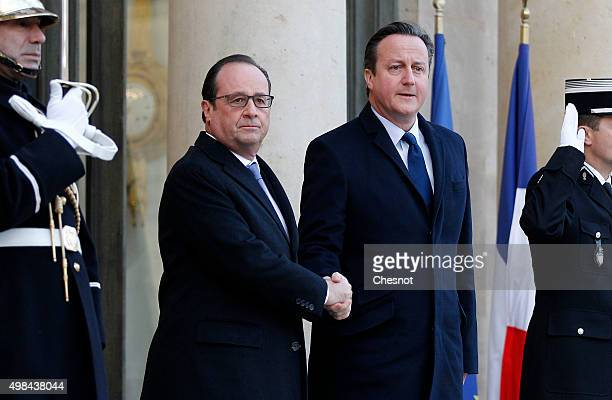 French President Francois Hollande welcomes British Prime Minister David Cameron prior to attend a meeting at the Elysee Presidential Palace on...