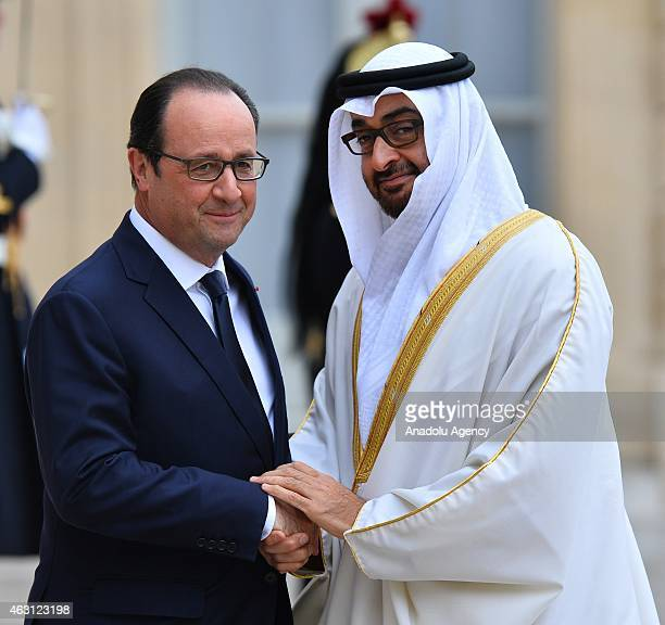French President Francois Hollande welcomes Crown Prince of Abu Dhabi, Mohammed bin Zayed Al Nahyan prior to their meeting at the Elysee Palace in...