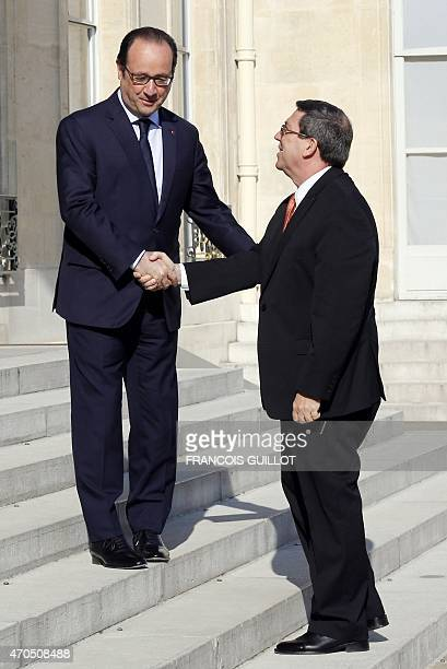 French President Francois Hollande welcomes Cuba's Foreign minister Bruno Rodriguez at the Elysee Palace in Paris, on April 21, 2015. AFP...