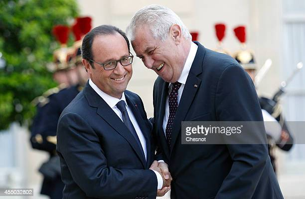 French president Francois Hollande welcomes Czech Republic's president Milos Zeman prior a meeting at the Elysee Palace on September 2014 in Paris...