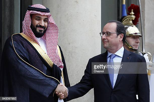 French President Francois Hollande welcomes deputy crown Prince and Defense Minister of Saudi Arabia Mohammed Bin Salman Al Saud prior to a meeting...