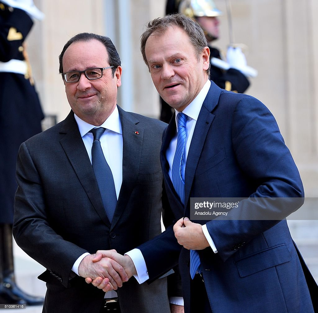 French President Francois Hollande (L) welcomes European Council President Donald Tusk (R) at the Elysee Palace in Paris, France on February 15, 2016.