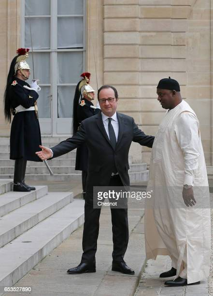 French President Francois Hollande welcomes Gambian President Adama Barrow prior to a meeting at the Elysee Presidential Palace on March 15 2017 in...