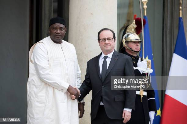 French President Francois Hollande welcomes Gambian President Adama Barrow before their meeting at the Elysee Palace on March 14 2017 in Paris France...