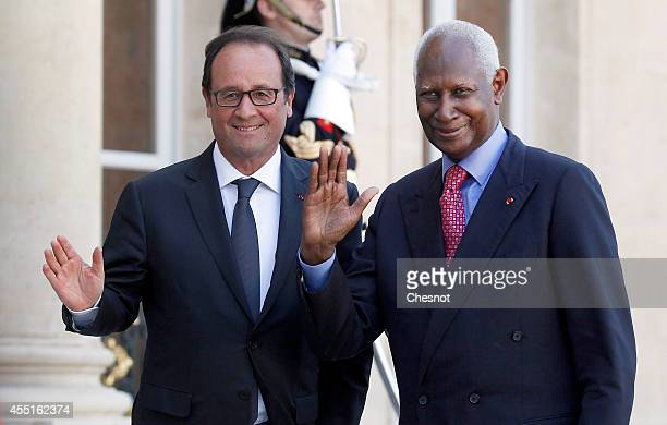 French President Francois Hollande welcomes General Secretary of the International Organisation of Francophonie and former Senegalese President Abdou...