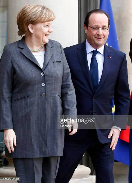 French President Francois Hollande welcomes German Chancellor Angela Merkel at the Elysee Palace on February 19 2014 in Paris France German...