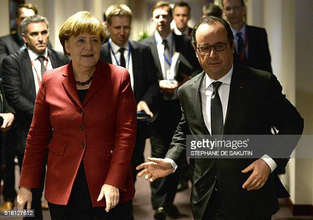 French President Francois Hollande welcomes German Chancellor Angela Merkel prior a meeting with Greece's Prime Minister Alexis Tsipras during an EU...