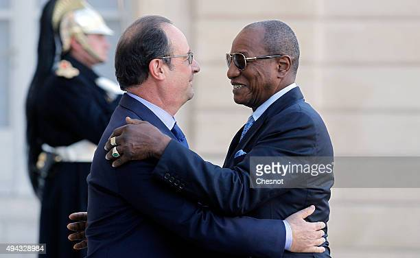French President Francois Hollande welcomes GGuinea President Alpha Conde at the Elysee Presidential Palace on October 26 2015 in Paris France...