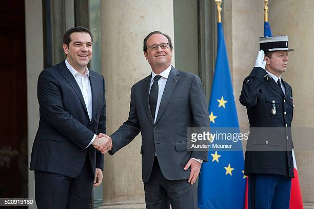 French President Francois Hollande welcomes Greek Prime Minister Alexis Tsipras at Elysee Palace on April 13 2016 in Paris France The leaders...