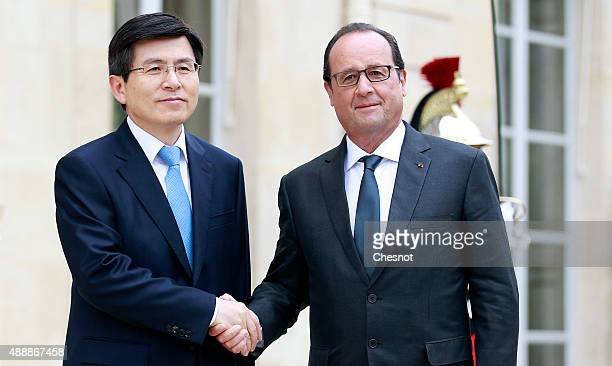 French President Francois Hollande welcomes Hwang KyoAhn Korea's Prime Minister prior to their meeting at Elysee Presidential Palace on September 18...