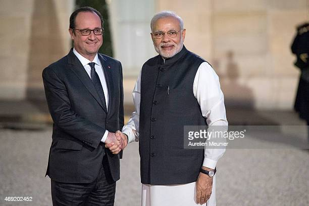 French President Francois Hollande welcomes Indian Prime Minister Narendra Modi to the Official Dinner in honor of the Prime Minister at Elysee...