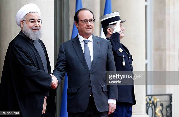 French President Francois Hollande welcomes Iranian President Hassan Rouhani prior to attend a meeting at the Elysee Presidential Palace on January...