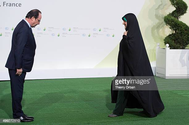 French President Francois Hollande welcomes Iranian VicePresident Masoumeh Ebtekar during the COP21 United Nations Climate Change Conference on...