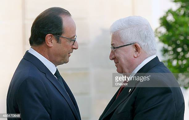 French President Francois Hollande welcomes Iraqi President Fouad Massoum prior a meeting at the Elysee Palace on September 15 in Paris France France...