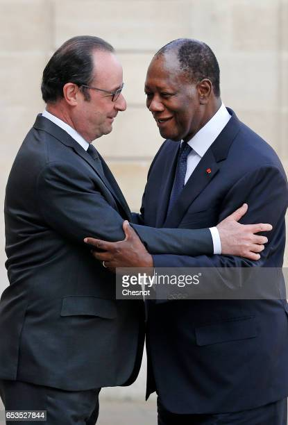 French President Francois Hollande welcomes Ivory Coast president Alassane Ouattara prior to a meeting at the Elysee Palace on March 15, 2017 in...