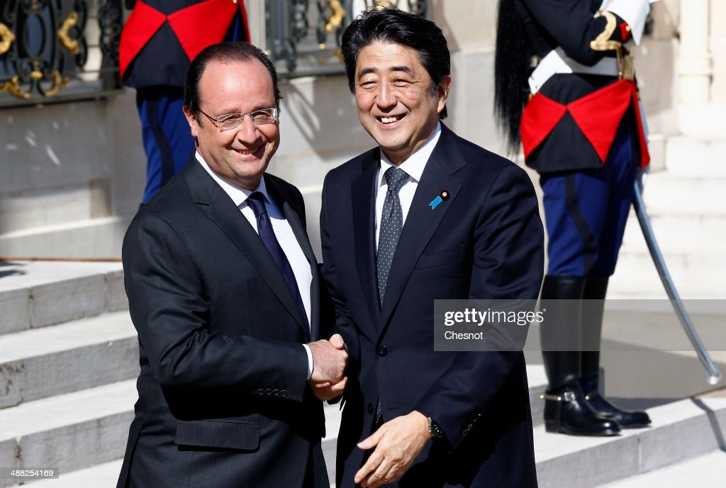 French President Francois Hollande welcomes Japanese Prime Minister Shinzo Abe at the Elysee presidential palace on May 5, 2014 in Paris, France. Japanese Prime Minister Shinzo Abe arrived in France on May 4 for trade and security talks, the latest leg of a six-nation European tour at a time of mounting tensions with China.