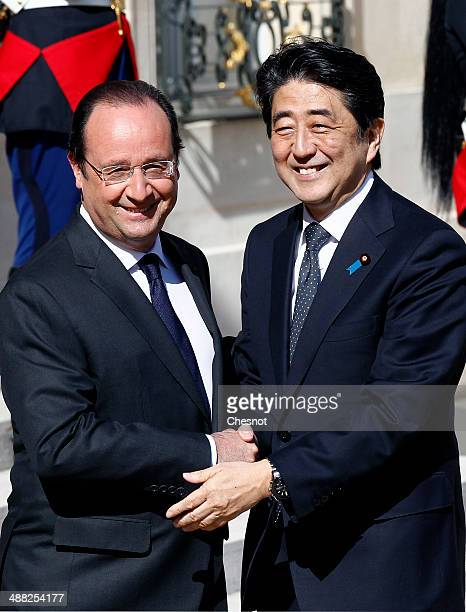 French President Francois Hollande welcomes Japanese Prime Minister Shinzo Abe at the Elysee presidential palace on May 5 2014 in Paris France...