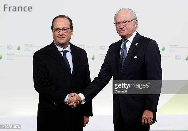 French President Francois Hollande welcomes King Carl Gustaf of Sweden as he arrives for the COP21 United Nations Climate Change Conference on...