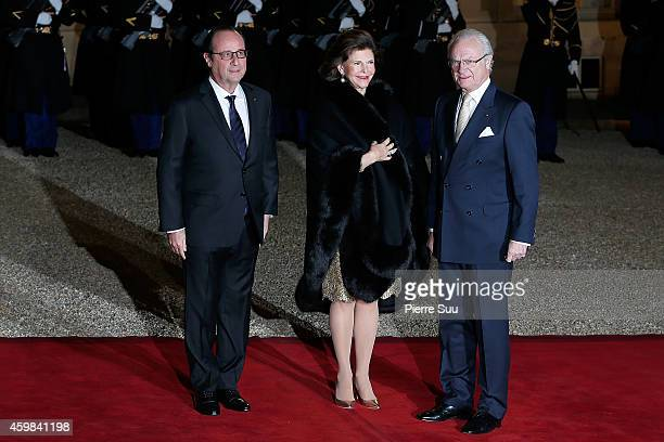 French President Francois Hollande welcomes King Carl Gustav of Sweden and Queen Silvia of Sweden for a state dinner at the Elysee presidential...