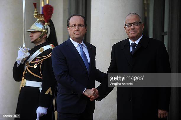 French President Francois Hollande welcomes Libyan Prime Minister Ali Zeidan for the Peace And Safety In Africa Summit at Elysee Palace on December...
