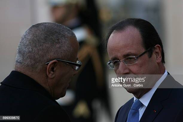 French President Francois Hollande welcomes Libyan Prime Minister Ali Zeidan for the Peace And Safety In Africa Summit at Elysee Palace in Paris