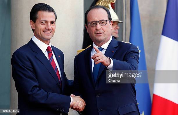 French President Francois Hollande welcomes Mexican President Enrique Pena Nieto prior to a meeting at the Elysee Palace on July 16 2015 in Paris...