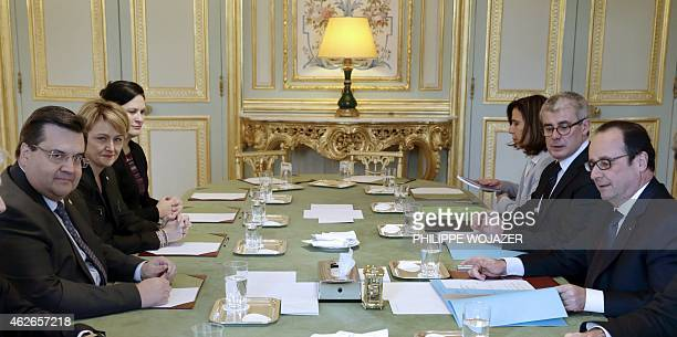 French President Francois Hollande welcomes Montreal's Mayor Denis Coderre at the Elysee Palace in Paris on February 2 2015 AFP PHOTO / POOL /...
