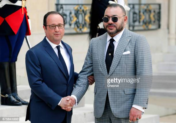French President Francois Hollande welcomes Moroccan King Mohammed VI as he arrives for a meeting at the Elysee Palace on May 022017 in Paris France...