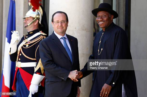French President Francois Hollande welcomes Nigeria's President Goodluck Jonathan upon his arrival to an African security summit on May 17 at the...