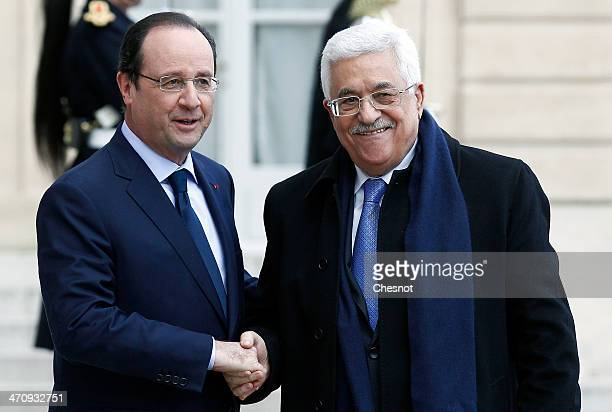 French President Francois Hollande welcomes Palestinian President Mahmoud Abbas at the Elysee Palace on February 21 2014 in Paris France Ideas...