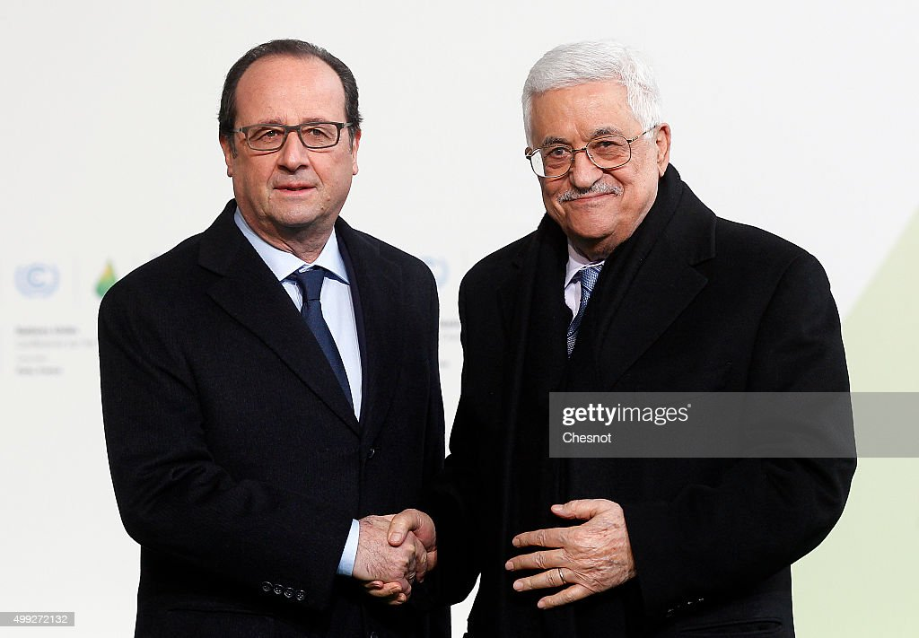 French President Francois Hollande welcomes Palestinian President Mahmoud Abbas (R) as he arrives for the COP21 United Nations Climate Change Conference on November 30, 2015 in Le Bourget, France. More than 150 world leaders are meeting for the 21st Session of the Conference of the Parties to the United Nations Framework Convention on Climate Change (COP21/CMP11), from November 30 to December 11, 2015.