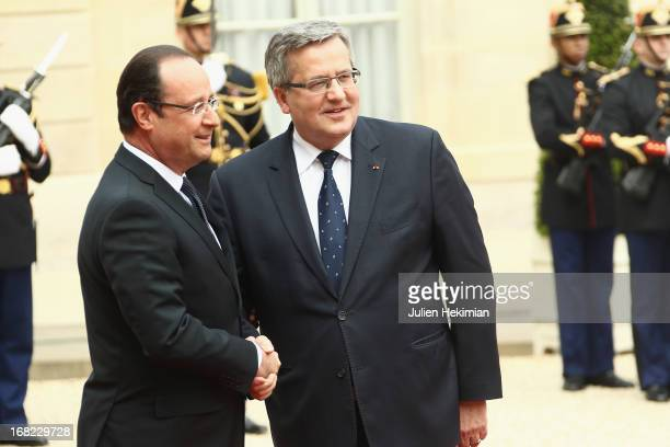 French President Francois Hollande welcomes Poland's President Bronislaw Komorowski at Palace Elysee on May 7 2013 in Paris France