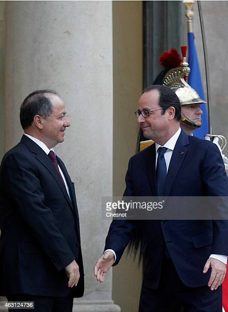 French President Francois Hollande welcomes President Massoud Barzani of Iraqi Kurdistan upon his arrival for a meeting at the Elysee palace on...