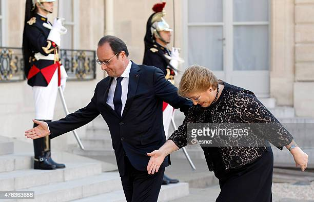 French President Francois Hollande welcomes President of Chile Michelle Bachelet prior to a meeting at the Elysee Palace on June 08 in Paris France...