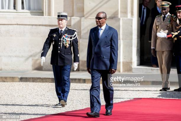 French President Francois Hollande welcomes President of Guinea Alpha Conde for a meeting at the Elysee Palace on April 11 2017 in Paris France This...