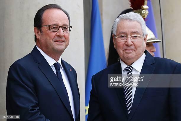 French president Francois Hollande welcomes President of the Algerian Senate Abdelkader Bensalah at the Elysee Palace in Paris on september 19 2016 /...