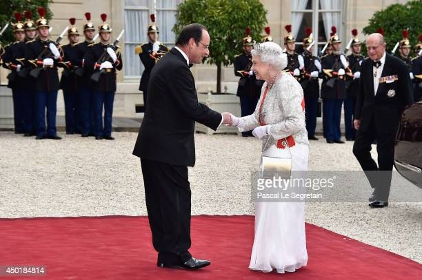French President Francois Hollande welcomes Queen Elizabeth II at the Elysee Palace for a State dinner in honor of Queen Elizabeth II, hosted by...