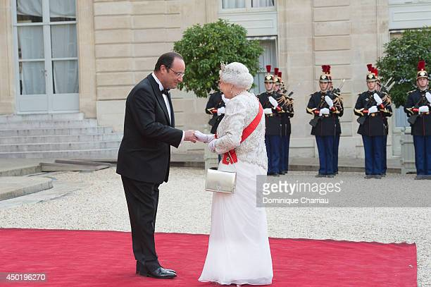 French President Francois Hollande welcomes Queen Elizabeth II at the Elysee Palace for a State dinner in honor of Queen Elizabeth II hosted by...