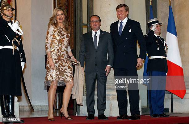 French President Francois Hollande welcomes Queen Maxima of the Netherlands and King WillemAlexander of the Netherlands prior to attend a state...