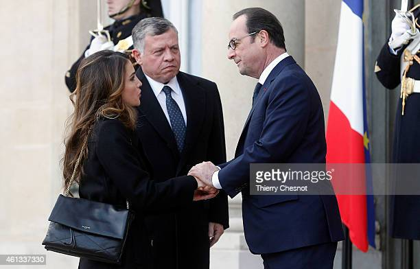 French President Francois Hollande welcomes Queen Rania and King Abdullah II of Jordan at the Elysee Palace before attending a Unity rally in tribute...