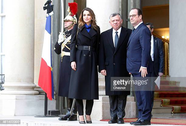 French President Francois Hollande welcomes Queen Rania and King Abdullah II of Jordan at the Elysee Palace before attending a Unity rally 'Marche...
