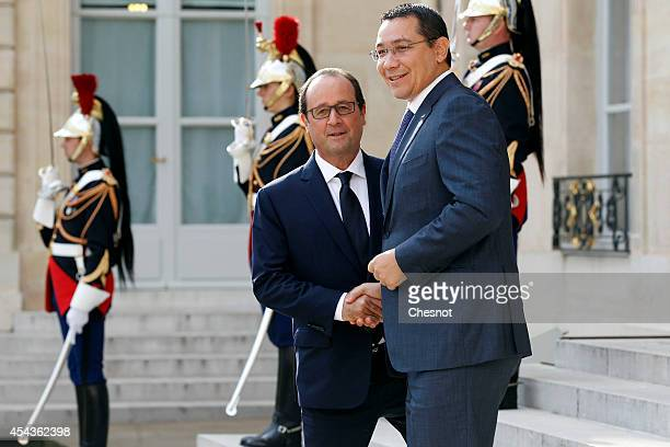 French president Francois Hollande welcomes Romanian Prime Minister Victor Ponta at the Elysee presidential palace on August 30 2014 in Paris France...