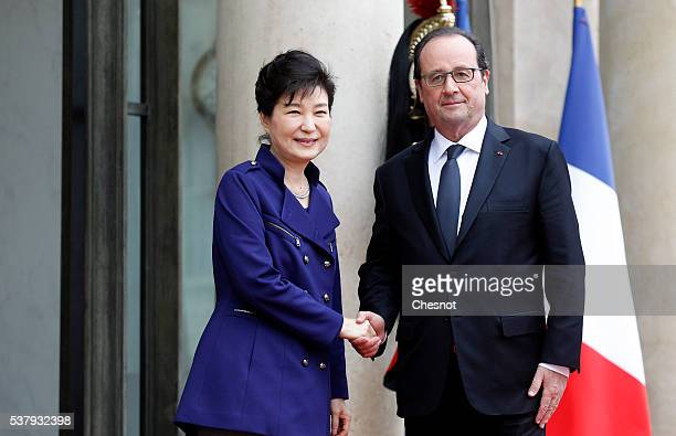 French President Francois Hollande welcomes South Korean President Park Geun-hye prior to a meeting at the Elysee Presidential Palace on June 3, 2016...